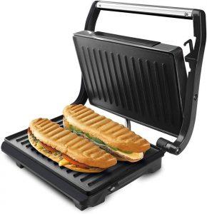 Taurus Grill & Toast - Sandwichera con placas grill antiadherentes, 700 W, tapa basculante, gancho fijo de cierre, bandeja recoge grasas, color negro